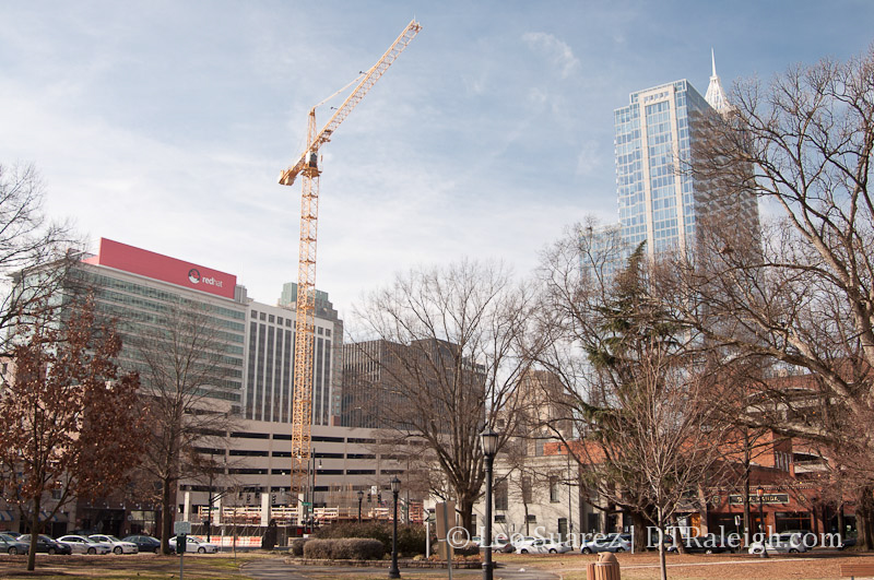 Moore Square with Skyhouse Raleigh under construction in view.