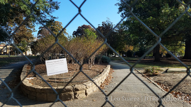 Construction fencing around Moore Square