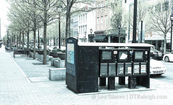 An empty newsstand on Fayetteville Street