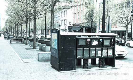 An empty newsstand on Fayetteville Street