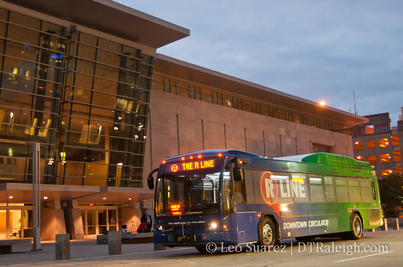 An R-Line bus in front of the Raleigh Convention Center