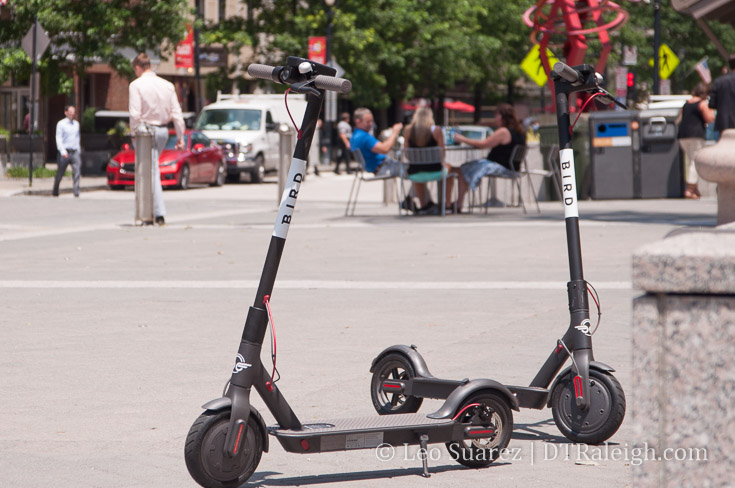 Two electric scooters in City Plaza