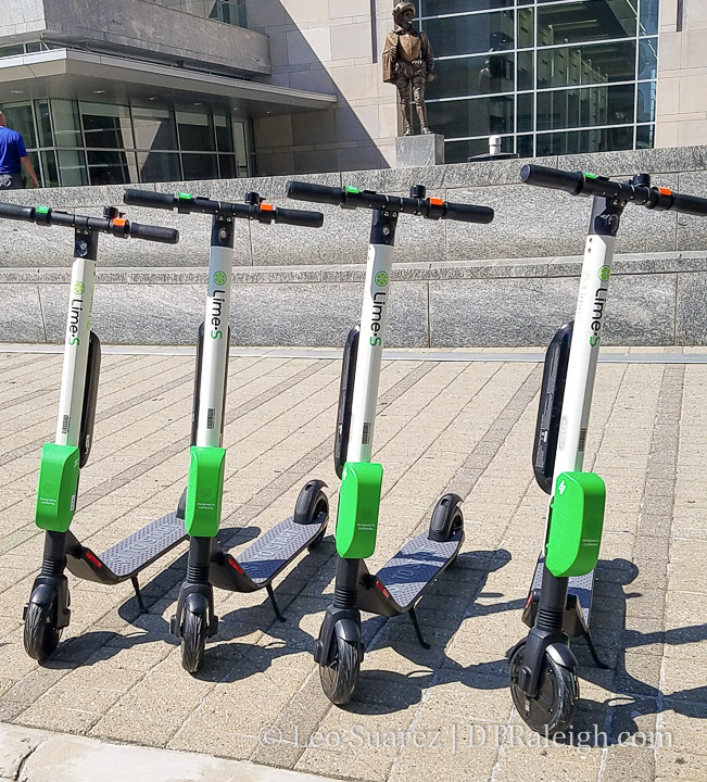 Lime scooters in front of the Raleigh Convention Center
